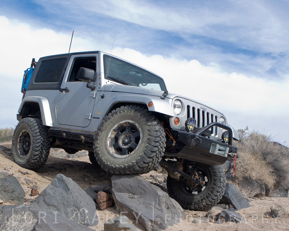 Jeep climbing over rocks in the Mojave Desert