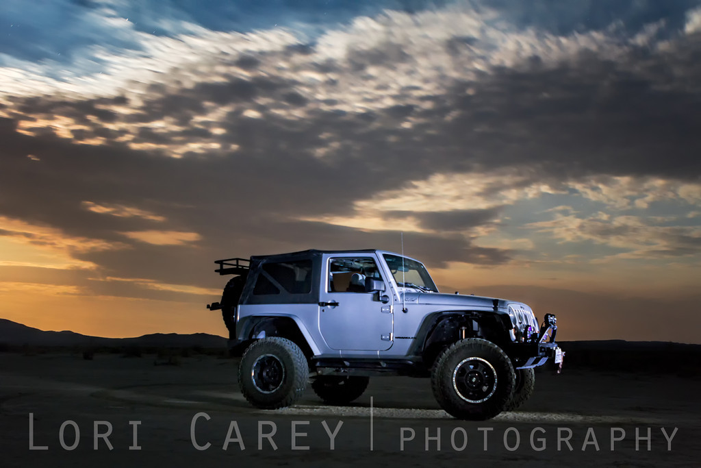 Jeep at sunset on desert playa
