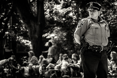 Police officer at Memorial Day parade on East High Street in Mount Vernon, Ohio. Date: May 28, 2012