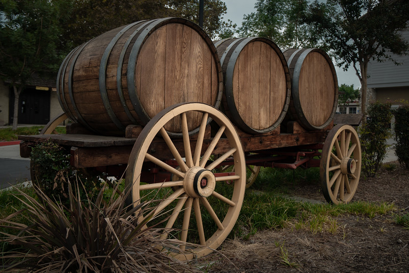 Wine barrels on a wagon at the Thomas Winery Plaza
