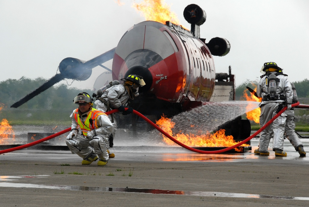 STEWART AIRPORT NEWBURGH, NY --Members of the 105th Air Wing Fire Department douse flames during a multi-organization training exercise here May 16, 2009.  The training was coordinated by the Port Authority of N.Y. and N.J. and takes place every three years and involves the department along with several civilian emergency service agencies.