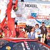 JOLIET, IL --Dale Earnhardt Jr. celebrates after winning the NASCAR USG Sheetrock 400 July 11, 2005.