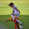ST. GEORGE'S, GRENADA -A Costa Rican player leaps over a Grenadian in a fight for the ball during a World Cup Qualifying match June 14, 2008.  The game ended in a 2-2 tie.
