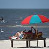 A couple enjoys a beautiful day on the beach in Biloxi.