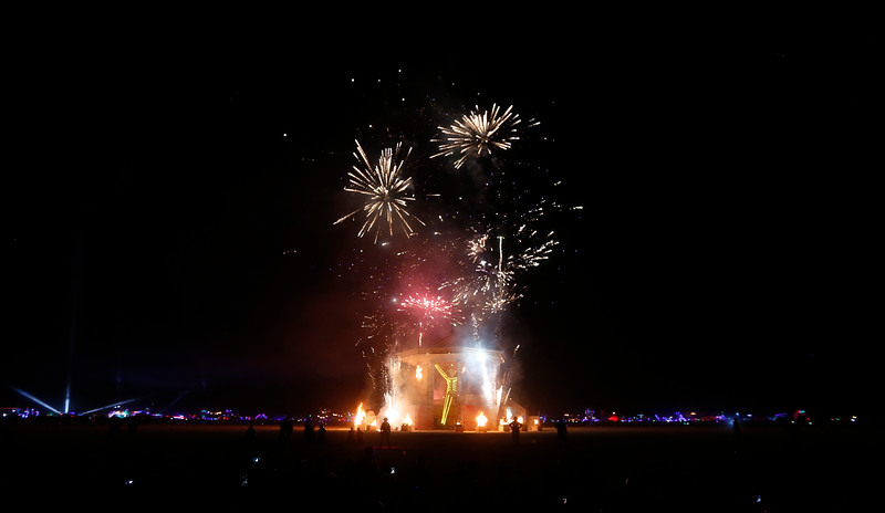 Participants watch the annual burning of the Man during the annual Burning Man arts and music festival in the Black Rock Desert of Nevada on Sept. 2, 2017.