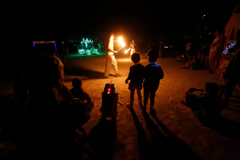 Children watch fire dancers during the annual Burning Man festival in Black Rock Desert, Nev. on Aug. 30, 2017.