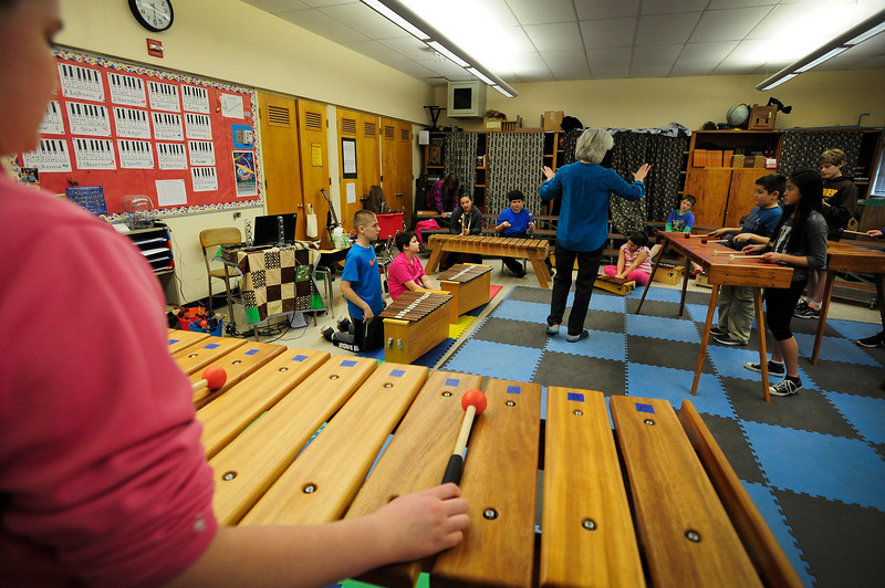 Hillcrest Elementary School music teacher Sharon Rodgers, center, leads a rehearsal for the newly launched fifth grade marimba band funded by a Coquille Tribal Community Fund grant on February 7, 2017.