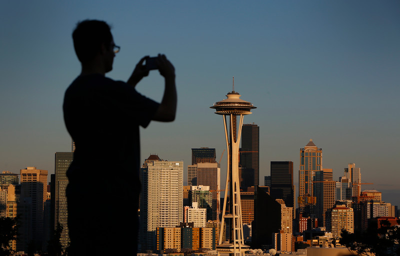 A man takes a photo at Kerry Park in Seattle, Washington on June 25, 2016.