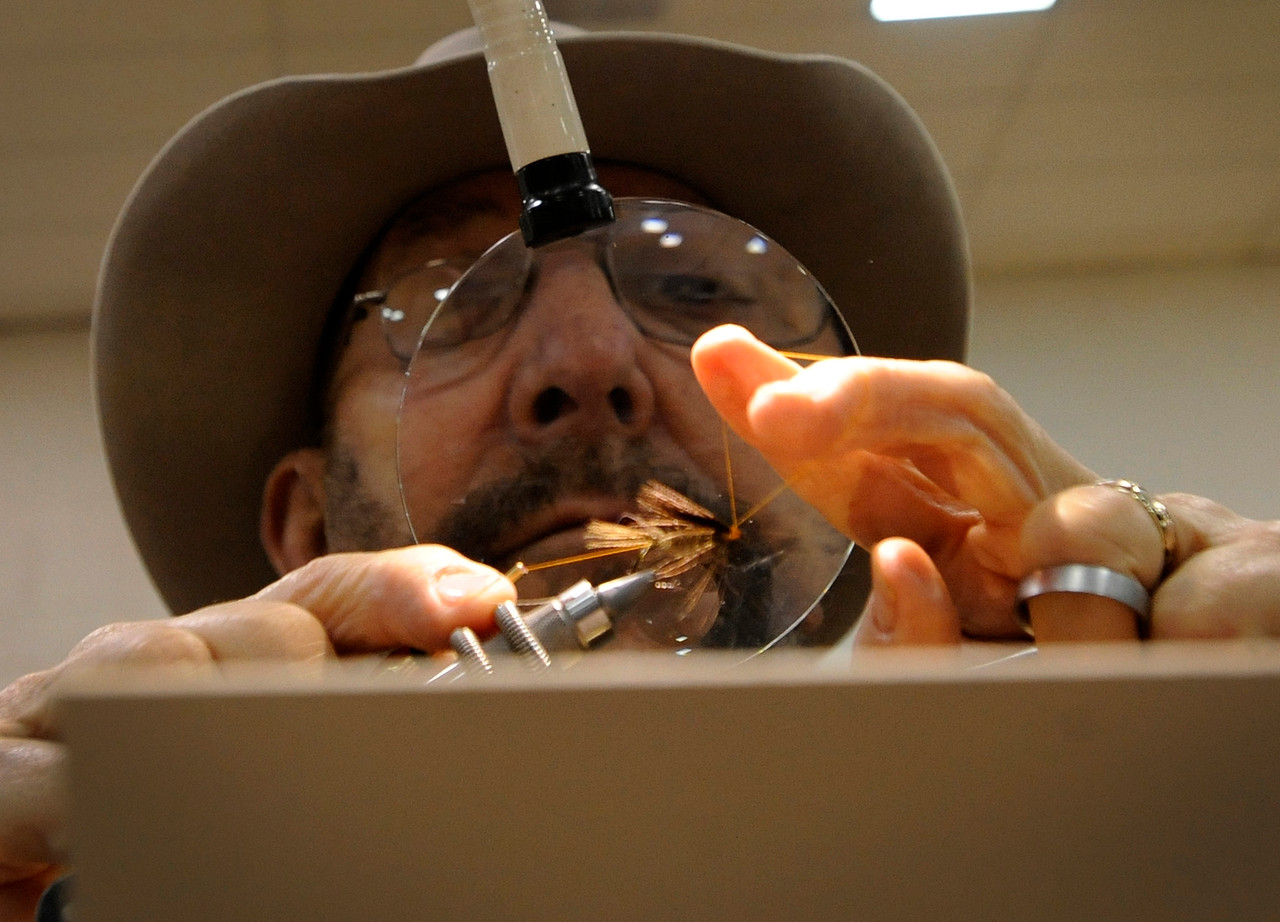 David Roberts with Fly Tyer's Den ties a fly during the Lower Umpqua Fly Casters Exposition at the Reedsport Community Center on Saturday.
