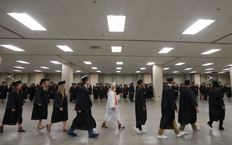 Students line up before the graduation ceremony for Billings Senior High School at the Rimrock Auto Arena at MetraPark on May 27, 2018.