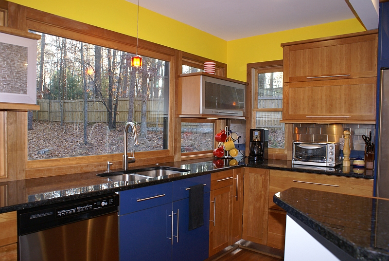 Backer kitchen<br /> New window arrangement at sink wall designed to keep view of wooded lot while allowing integration with new cabinet design for more useable space.