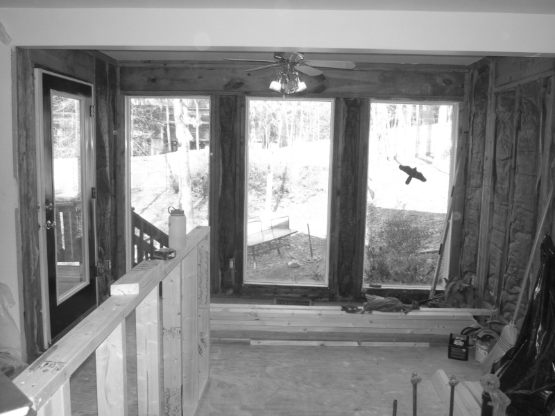 Before: Backer kitchen<br /> Floor to ceiling windows at back wall scheduled to be reconfigured to integrate with cabinet design.  Kitchen partition walls at camera position and to left of photo were removed to create more open space as a great room.