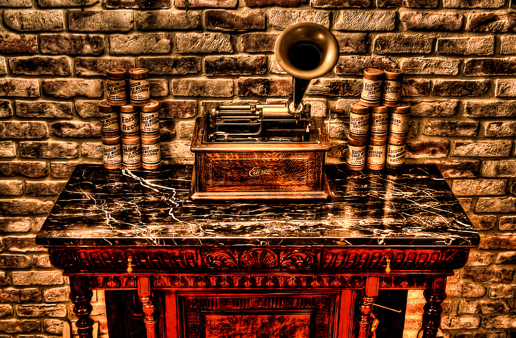 "35/365 Edison Triumph Phonograph - Thomas Edison invented the first Phonograph on August 12, 1877. Edison was trying to improve the telegraph transmitter when he noticed that the movement of the paper tape through the machine produced a noise resembling spoken words when played at a high speed. Experimenting with a stylus (hard-pointed instrument like a large needle) on a tinfoil cylinder, Edison spoke into the machine. To Edison's surprise, the cylinder recorded his message, ""Mary had a little lamb."" People had a hard time believing his discovery at first, but soon doubt turned into awe as Edison became known as ""The Wizard of Menlo Park,"" after the name of the city in New Jersey where he did his work. - © Simpson Brothers Photography"