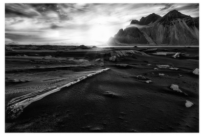 The sun rises from behind the Mountains (Iceland)