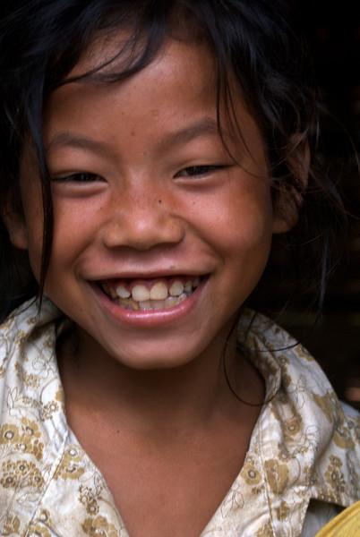 LUANG PRABANG AREA. BORHIA (SAY: BOHE) VILLAGE. LITTLE LAO GIRL. LAOS.