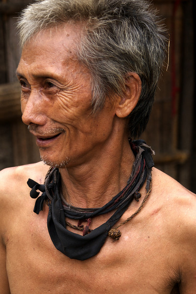 LUANG PRABANG. SANOUK VILLAGE. PORTRAIT OF OLD MAN FROM THE H'MONG TRIBE. LAOS.
