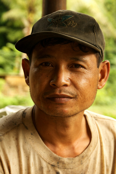 KHAMU VILLAGE. PORTRAIT OF A WORKER MAN. LUANG PRABANG AREA. LAOS.
