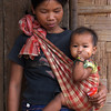 LUANG PRABANG AREA. BORHIA (SAY: BOHE) VILLAGE. KHAMU MOTHER WITH BABY. LAOS.