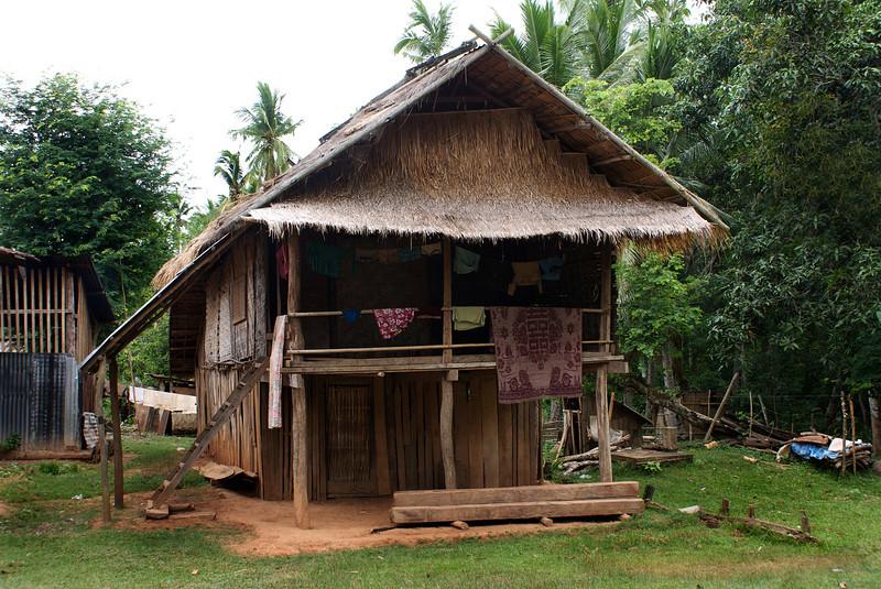 SANOUK VILLAGE. HOUSE OF H'MONG TRIBE PEOPLE. LUANG PRABANG AREA. LAOS.