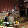 LAO BOY IN HIS BACKYARD. LAOS.