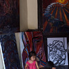 LUANG PRABANG. KIDS PLAYING IN ART SHOP.