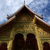 LUANG PRABANG. NATIONAL MUSEUM. CARVED GOLDEN FACADE OF THE ROYAL WAT [TEMPLE]