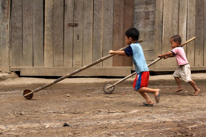 LUANG PRABANG AREA. NATAN VILLAGE. LAO CHILDREN PLAYING.