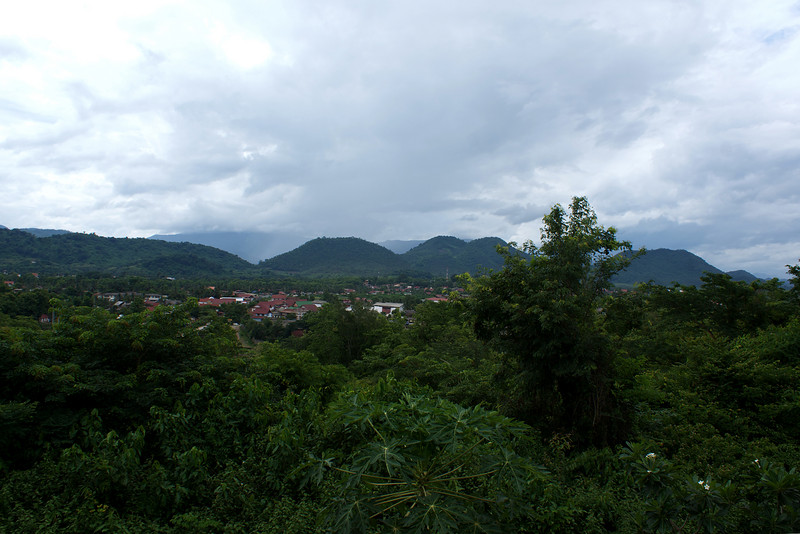 LUANG PRABANG. VIEW OF THE CITY SURROUNDED BY THE GREEN MOUNTAINS.