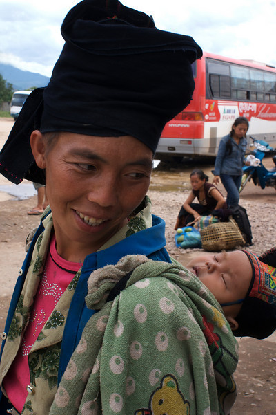 UDOMXAI. TRIBE WOMAN WITH A BABY. NORTHERN LAOS.