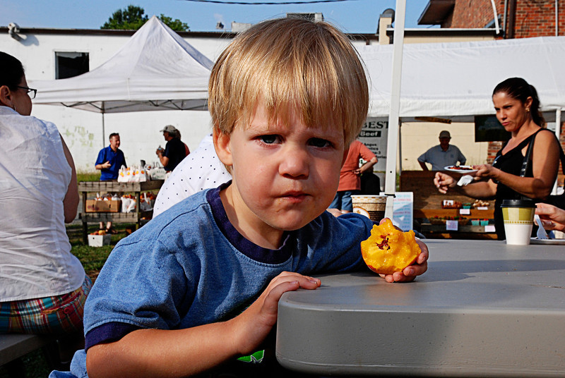 Boy Eating Peach at Farmers Market<br /> Matthews, NC