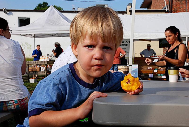 Boy Eating Peach at Farmers Market<br /> Matthews, NC