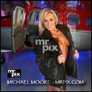 Model shoot for Playboy Magazine, in airplane hanger lighting setup on Playboy shoot