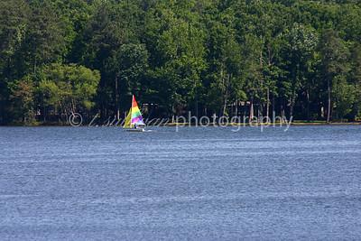 A colorful sailboat on Swift Creek Reservoir