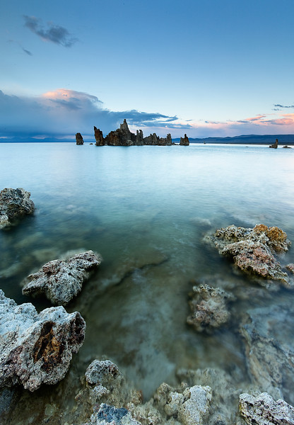 A serene summer sunset over Mono Lake in California's Eastern Sierra Nevada.  The lake is a fascinating, almost otherworldly, location that begs to be photographed.  Prominently featured here are the formations for which the lake is famous for: tufas.