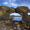 <H3> Natural Windows </H3> The southwest coast of Snaefellsnes peninsula is full of these natural rock formations and makes for a very interesting hike. This spot is close to the town of Arnarstapi.
