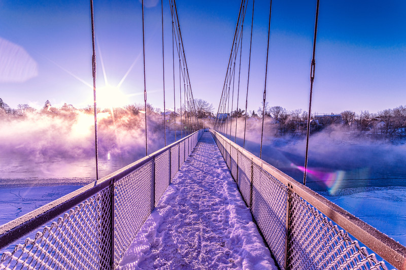 "The Androscoggin Swinging Bridge, Brunswick, Maine just after dawn.  It was cold enough that beautiful mist 20-30 feet high swirled and undulated over the surface of the river and all around me as I photographed this beautiful spectacle!  You can read more about this bridge here: <a href=""http://en.wikipedia.org/wiki/Androscoggin_Swinging_Bridge"">http://en.wikipedia.org/wiki/Androscoggin_Swinging_Bridge</a>"