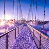 """The Androscoggin Swinging Bridge, Brunswick, Maine just after dawn.  It was cold enough that beautiful mist 20-30 feet high swirled and undulated over the surface of the river and all around me as I photographed this beautiful spectacle!  You can read more about this bridge here: <a href=""""http://en.wikipedia.org/wiki/Androscoggin_Swinging_Bridge"""">http://en.wikipedia.org/wiki/Androscoggin_Swinging_Bridge</a>"""