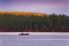 Fisherman on lake in Rural Maine.