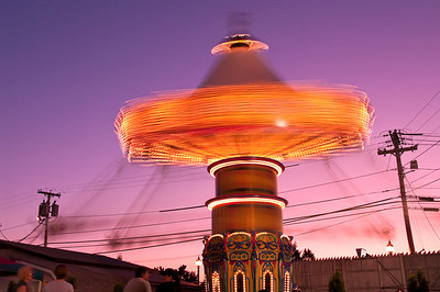 Old Orchard Beach swings at twilight.