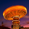 Old Orchard Beach's swings on a long exposure at twilight.