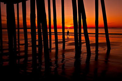 The Human Element A lone figure walks among the pilings of the Old Orchard Beach pier during a glorious sunrise.