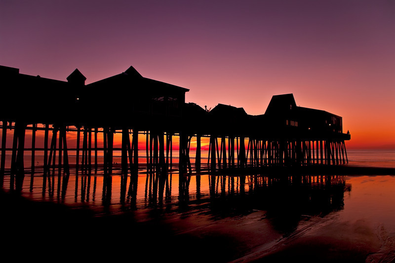 Old Orchard Beach Pier in silhouette at dawn