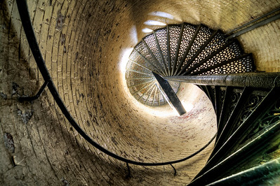 Inside Portland Head Light Cape Elizabeth, Maine The elegant, winding, spiral staircase that leads up to a stunning panoramic view of Cape Elizabeth and the Atlantic Ocean.