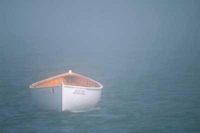 The Fog Creeps In. . . This lonely dory was floating in a dense fog bank just off South Portland's Willard Beach on a Sunday afternoon.
