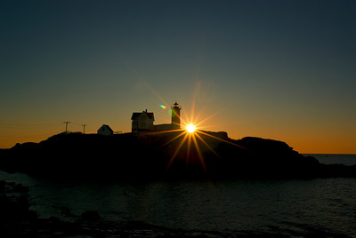 Silhouetted Nubble Light, York, Maine.