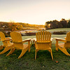 Adirondack chairs overlook a beautiful misty sunrise on the River Road in York, Maine. 2