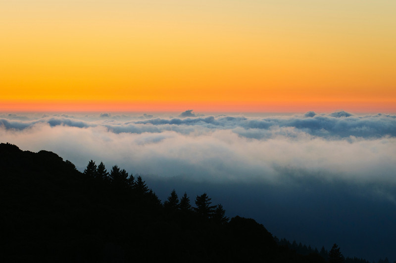 """""""On Top of the World""""   Fog at Sunset at Mt. Tamalpais in the Marin Headlands near San Francisco.  While shooting the harvest moon, I captured the awesome sunset beneath the fog.  Just an awesome sunset to end Summer."""