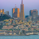 """San Francisco Skyline with the Mandarin Oriental Hotel and Transamerica Pyramid at Dusk""  Just another fantastic view of the San Francisco Skyline at dusk with the glow of the sun on the Transamerica Pyramid and Mandarin Oriental Hotel.  It took me quite a few trips to get a clear day view of the Skyline without fog!!   Another day for an amazing view!"