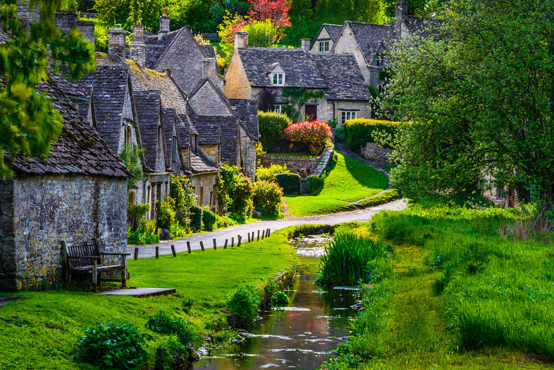 """""""Sunlight on Arlington Row in the Cotswolds"""" The sun broke through the clouds lighting up these beautiful cottages built in 1380 in the heart of the Cotswolds. The best part was having no tourists in the picture on a holiday weekend!! Add this to your place of must visit stops in the English countryside! — at Arlington Row, Bibury. Gloucestershire near Oxfordshire, England, United Kingdom."""