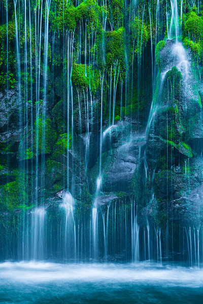 """""""Tranquility""""  With the waterfall dripping down the moss in spring in the Mount Shasta, California area, you can hear and feel the water and mist spritzing you.  It makes you feel as if you are in a tropical rain forest.  This California Waterfall is just a soothing backdrop for any home, office, hospital or Executive Briefing Center."""